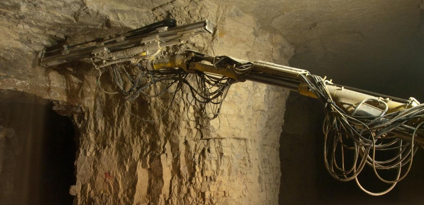 Photo: TKDZ: A machine mines rock underground.
