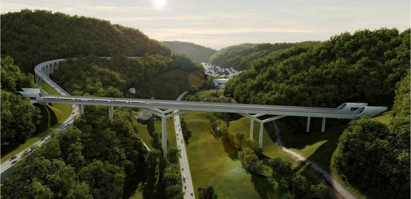 Photo: Visualisation of a valley between wooded hills, in the middle of the picture the bridge leads from tunnel to tunnel