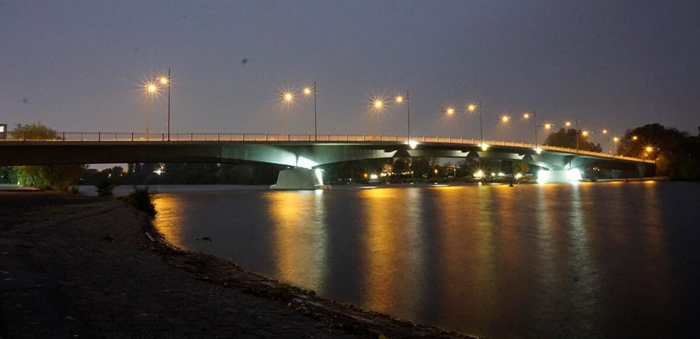 Photo: Night photo of the brightly illuminated bridge crossing the river Main