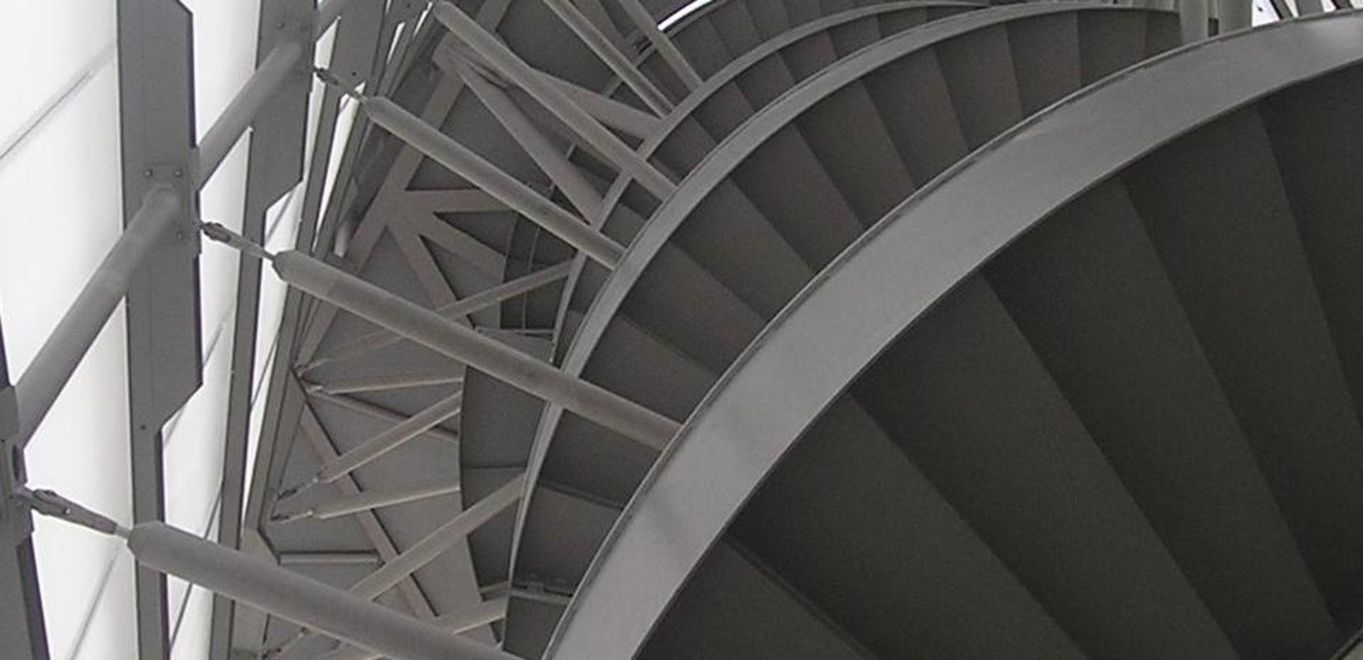 Photo: BBI Infotower: Interior view form a worm's-eye view: On the right hand side the steel staircase surrounding the tower's concrete core, on the left the steel structure covered in the membrane foil